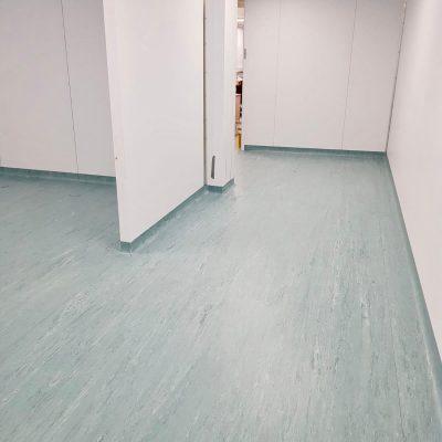 Hospital corridor image light green flooring